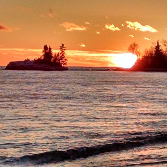 Sunset on Lake Superior right out your door and deck.