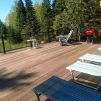 Lounge chairs, adirondacks and grill area