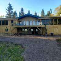 Twelve Mile Rock east side is part of our VRBO rental with a lovely screen porch