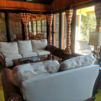 In front of you is the living room, conversation area thru to screen porch